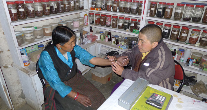 Ani Tsering Dolma (right), a nun and traditional Tibetan medical practitioner, diagnoses a patient's illness in a health post supported by Nepal SEEDS.  Photo by Geoff Childs.