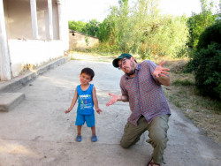 A Boy Named Azizbek and I Making Faces in Beshkube Village, Uzbekistan.
