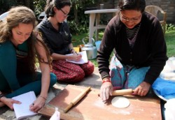 Students learning how to make roti, a commonly eaten Nepali flatbread. Photo by Nikki Freihofer